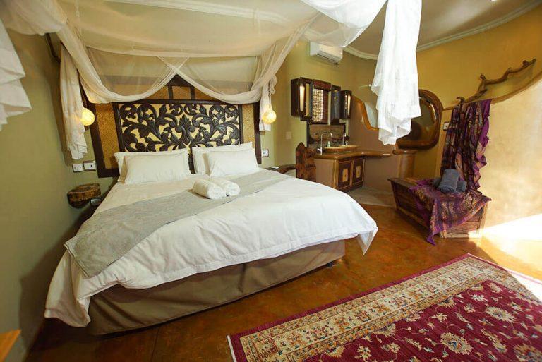 Luxury Bed Side View I AMness Leopards Rock Bush Boutique