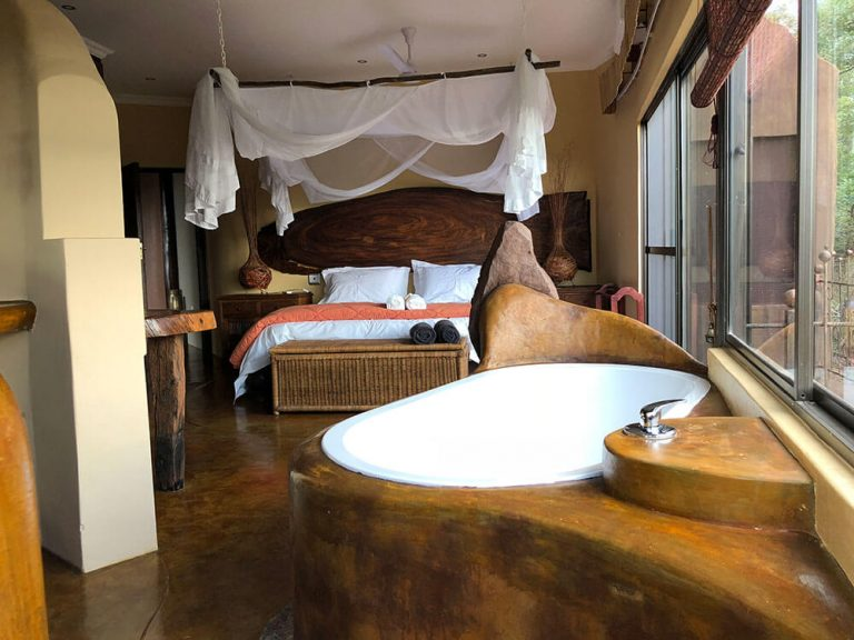 View of Bedroom from Bath IAMNess Leopards Rock Bush Boutique